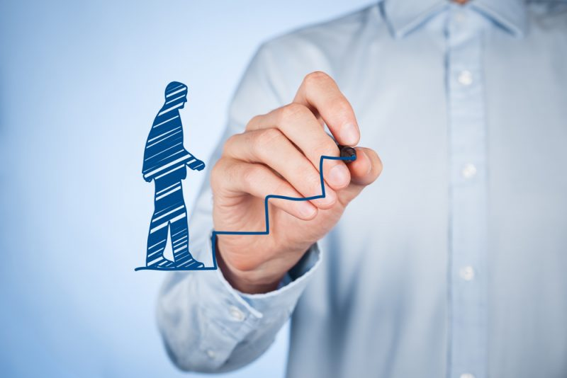 Personal development (personal growth), success, progress and potential concepts. Male coach (human resources officer, supervisor) draw stairs to help employee with his growth.